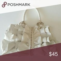 """Bebe bag Bebe white leather ruffle bag. Totally clean. Interior pockets & a zipper pocket. Good size. 14""""lX9""""wX11""""d Thick braided Handles. Ruffles on both sides. Interior is perfect. No stains. bebe Bags Shoulder Bags"""