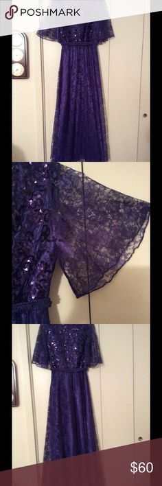 Vintage Mike Benet lace and sequin formal gown. Sequined top with lace butterfly sleeves and lace overlay skirt.  Waist is elastic.  The detachable belt is lace with a flat hook and bar fastener.  The color is a beautiful eggplant/aubergine. Mike Benet Dresses Prom