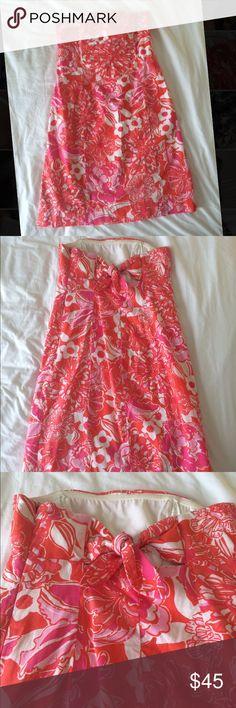 Lilly Pulitzer dress size 2 Strapless orange, pink and white dress. Hidden zipper on side. Tie detail in the back Lilly Pulitzer Dresses Strapless