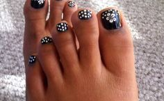 My attempt to get in the Halloween spirit. The all black nail polish was too hideous of a match for my toes so I added polka-dots and flowe...