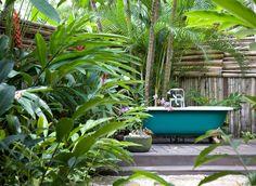 Hotels Luxury Travel plant palm tree green Garden flora tropics botany flower Jungle rainforest arecales backyard palm family botanical garden Resort yard plantation lawn outdoor structure