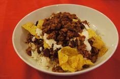 Classic Chilli Con Carne - served with sour cream & nacho's  This is the way i like to eat chilli con carne, drizzled with sour cream and sprinkled with nacho's. Served with plain boiled basmati rice. The style of this chilli uses no canned tomato's, instead uses sun dried tomato paste, and beef stock. It's quite a rich dish,don't eat too much too quickly.