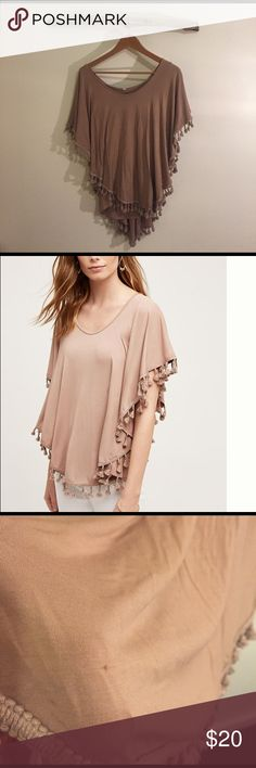 Anthropologie Tasseled Dolman Top Made by eri + ali taupe color. Beautiful drape, built in tank. Soft/stretchy material. Small snag (see image), otherwise great condition, only worn once and decided it is too big. Runs big. This is an XS and is too big (deep) in the neck and body. I would say it could fit a small no problem, possibly even a medium. Perfect for spring. Anthropologie Tops Blouses