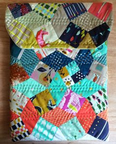 Squares and Diamonds. And I love the hand quilting!