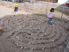 stone labyrinth.  Could do this or paint a maze or spiral at arts centre depending on ground.