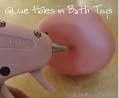 Use your hot glue gun to plug bath toy holes.