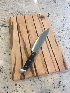 """Handmade, cutting board build in Meridian, Idaho. Made out of ambrosia maple and Purple Heart. This board is 16""""x10""""x3/4""""."""