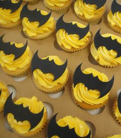 Batman Birthday Cupcakes--I may not be able to bake a fancy cake, but I think I could do this...