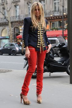 Red jeans. Navy military style jacket .  Leopard heels.  Outfit.