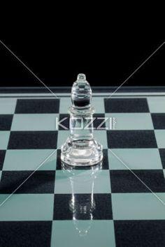 shiny chess bishop. - Image of shiny chess bishop on chess board.