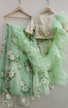 Pretty pastel green printed organza lehenga with sequins blouse and organza ruffle dupatta. Ideal for Mehendi, Sangeet, Reception or Destination weddings. Lehnga Dress, Lehenga Blouse, Floral Lehenga, Indian Dresses, Indian Outfits, Ethnic Outfits, Western Dresses, Indian Designer Outfits, Designer Dresses