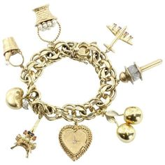 Preowned Wonderful 8 Charms Eiffel Tower Champagne Bucket Gold Charm... ($7,000) ❤ liked on Polyvore featuring jewelry, bracelets, multiple, gold heart locket, 14k gold pendant, gold charms, 14k yellow gold pendant and gold pendant