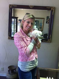 Jill strikes a pose with her new Ron Hami diamond studs and store mascot, Maltese puppy Angel Baby!
