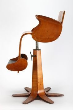 child's barbers chair, designed by Garth Chester 1953, Auckland New Zealand. Moulded plywood.   Collection of Auckland Museum F182