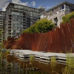 Tanner Springs Park, Portland, OR - cool corten steel pipe fence