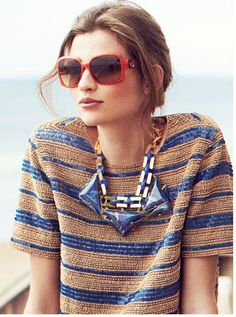 the red sunglasses add fun and youthful vibe