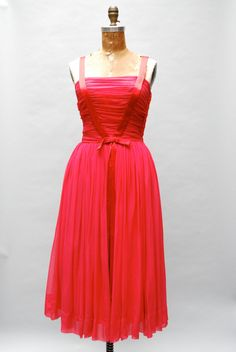 """Vintage 1950s stunning tomato red silk chiffon party dress with rushed bodice and satin """"V"""" detail that becomes straps and tapers to an elegant point in the back."""