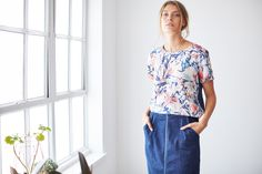Opt for our striking new season painted floral in this simple Tencel top. Featuring a contrasting navy back panel and zip detailing, pair this thoughtfully-designed floral top with your favourite trousers. Floral Tops, Trousers, Sari, Blouse, Archive, Zip, Clothes, Simple, Design