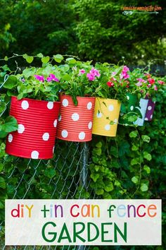Flower Garden Tin Can Flower Garden: easy and colorful idea to dress up a chain link fence! - A Colorful and Fun Tin Can Flower Garden Makes the Perfect Backyard Fence Decor Tin Can Flowers, Flowers Garden, Flower Pots, Flower Fence, Diy Flowers, Garden Crafts, Garden Projects, Garden Art, Outdoor Projects