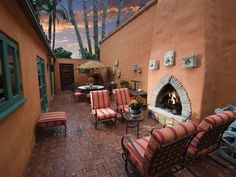 Santa Fe Rancho patio with adobe walls and matching skies.