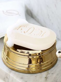 Gentleman's gold soap dish . . . http://www.kerlagons.com/body_care.html