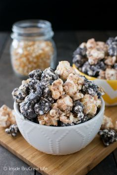 Butterfinger Cookies and Cream Popcorn - white chocolate covered popcorn coated in Oreo cookies and Butterfinger candy makes a fun and delicious snack mix