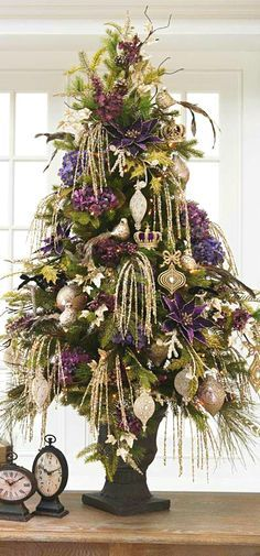 This is a pretty tree. Makes me think of New Orleans because of the purple and gold colors