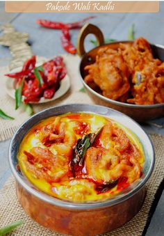 Pakode- or spicy fritters in Kadhi - made of mainly yogurt chickpea flour, tomatoes and  Indian spices