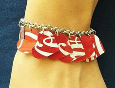 This charm bracelet is made using 12 hearts cut out of classic coke can. The hearts are hanged on a nickel free chain. This bracelet can fit any wrist size as its spring ring can be hooked to any link along the chain. Dimensions in inches: Each hearts length is 0.9 Dimensions in centimeters: Each hearts length is 2.2 cm  *****************************************************  This charm bracelet is also available in:  Colorful flowers using different drinking cans: https://www.etsy.c...