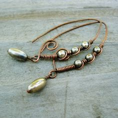 These are another fun derivation with almond wires -- Antiqued Copper & Silver Marquise Shaped Wrapped Hoops