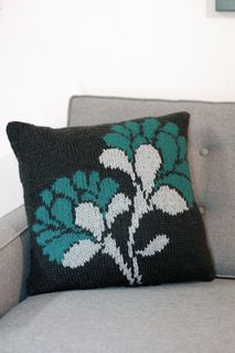 Spring, summer, fall or winter, these blooms will fill your home with radiance and life. Let the love in your home blossom with this knitted pillow pattern. The cushion is worked in Stockinette stitch, using three colors to create shadow and light. These brilliant bouquets illuminate every room without ever having to tip a watering can.