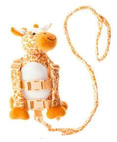 Mochila de segurança bege. Formato de girafa. Uma forma segura de manter os pequenos próximos a você em multidões ou locais abertos. Pode transformá-lo em mochila somente removendo a cauda. Alças ajustáveis e fivelas de segurança.
