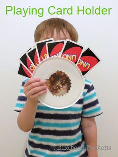 Very simple, upcycled playing card holder for kids. Perfect for children that can play a game of cards, but have a hard time holding and arranging their cards.