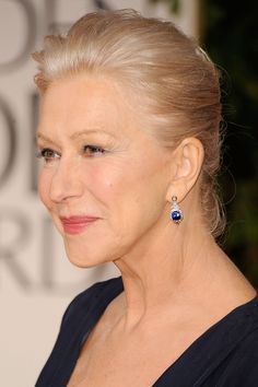 Helen Mirren Dangling Gemstone Earrings - Helen Mirren attended the 69th Annual Golden Globe Awards wearing a pair of 1950s sapphire and diamond pendant earrings in platinum.