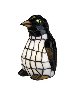 """8 Inch H Penguin Tiffany Glass Accent Lamp - 8 Inch H Penguin Tiffany Glass Accent LampThis adorable Penguin accent lamp is created fromEbony and Winter White stained art glass with eyes thatare made of glistening glass jewels. Theme: TIFFANY ANIMALS HOLIDAY Product Family: Penguin Tiffany Glass Product Type: NOVELTY LAMPS AND ACCESSORIES Product Application: LIGHTED SCULPTURES Color: BL CA HA Bulb Type: CNDL Bulb Quantity: 1 Bulb Wattage: 15WT Product Dimensions: 8""""H x 5""""W x 5DPackage…"""