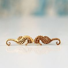 Gold Seahorse Earrings ,  PAIR of Seahorse Stud Earrings , Nautical Jewelry , 18k Gold plated brass nickel free by sigalitaJD on Etsy https://www.etsy.com/listing/237739718/gold-seahorse-earrings-pair-of-seahorse