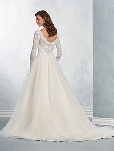 A romantic wedding gown with sweetheart bodice, scoop-neck yoke, sheer full-length sleeves, ball gown skirt, and semi-cathedral train.