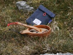 Miscellaneous Adventures Navigator Pouch, hand carved wooden Adventure Spoon and Polaris cup.