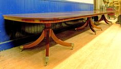 Selling for £6,500 - A large Regency style mahogany three pillar dining table 20 ft in length with 20 dining chairs