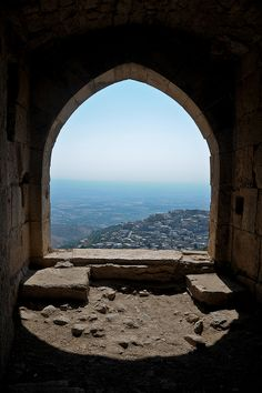View from one of the top most windows of the outside wall, showing the symetry of the architecture Krak Des Chevaliers, Inside Castles, Land Before Time, Cradle Of Civilization, Aleppo, Archaeological Site, Ancient Architecture, Ancient Civilizations, Middle East