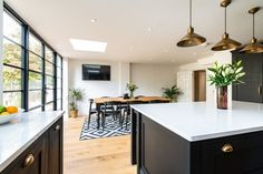 We recently fitted this beautiful bespoke kitchen for a lovely couple in Kent. The dark cabintery is hand painted in Mylands 'Sinner' and finished with brass handles and hinges. This kitchen is in our Westminster range - a classic framed shaker style. Open Plan Kitchen Dining Living, Open Plan Kitchen Diner, Living Room Kitchen, Kitchen Layout, Kitchen Design, Kitchen Diner Extension, House Extension Design, House Design, Chevrons