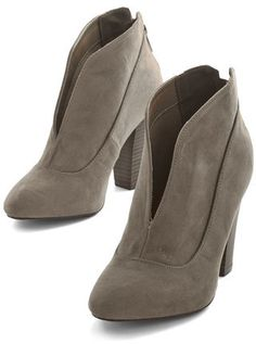 East Lion Corp./Qupid Letb, Hop out of bed and into these greyish-taupe-hued booties with fashionable enthusiasm! Flaunting a modern split-front, high-heeled silhouette, this vegan faux-suede pair jumpstarts your day with sleek, versatile panache.
