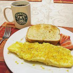 Breakfast.  #omlette #eggs #egg #cheese #cheddar #strawberry #toast #rye #coffee #starbucks #starfox