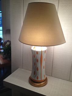 High Point Market Spring 2012-Bunny Williams Orange and White Ceramic Lamp for BeeLine Home.