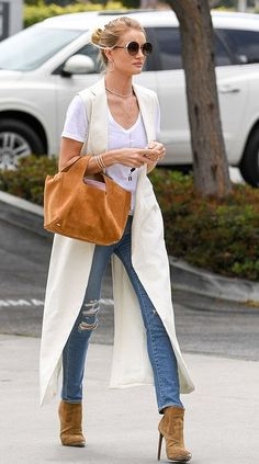 Rosie Huntington-Whiteley in Nomia paired with Saint Laurent booties and a The Row bag out & about in L.A. #bestdressed