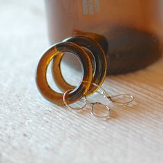 Our Beer Hoop Earrings are repurposed from the bottlenecks of various beer bottles. The brown glass on these earrings will vary in size from 1 to 1.5