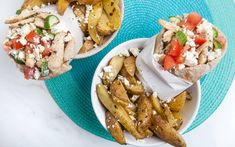 These authentic Mediterranean chicken souvlaki pitas are stuffed with Greek yogurt marinated cucumbers, fresh tomatoes, grilled chicken tossed with oregano and lemon juice, and crumbled feta, and served with a side of garlicky lemon-oregano potatoes. Tzatziki, Chicken Souvlaki Pita, Marinated Cucumbers, Mediterranean Chicken, What To Cook, Greek Recipes, Grilled Chicken, Greek Yogurt, Allrecipes