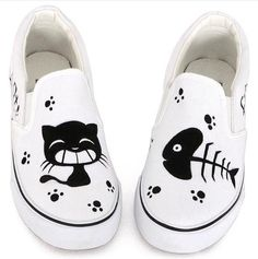 Cat and Fish Bone Slip On Canvas Sneakers. Cute and comfy! Great match fora pair of jeans or black leggings! The perfect cat themed accessory for cat owners!