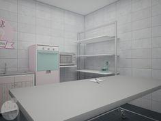 Vista interior de la cocina, con acero inoxidable y equipamiento