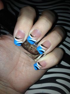 Blue french tip nails with a black and white design